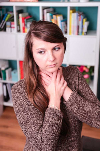 Young woman with hoarseness