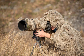 A cameraman wearing camouflage