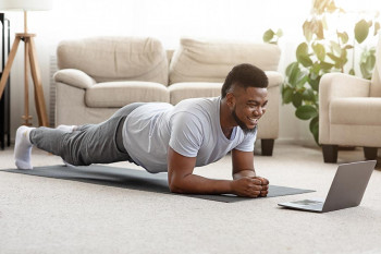 A man does healthy, in-home exercises