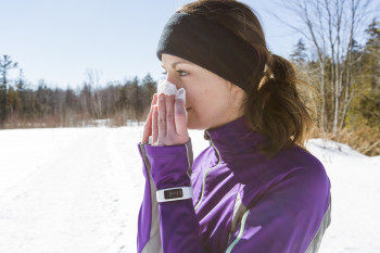 A woman gets a runny nose while running