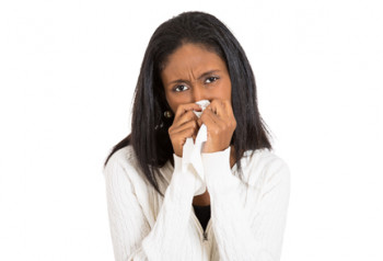 A woman with a nosebleed learns how to treat nosebleeds