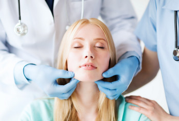 A woman at a facial plastic surgery consultation.