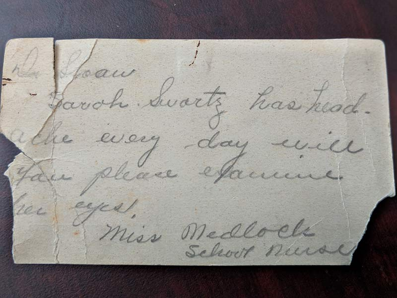 An old business card with patient care requests