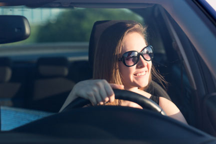 Girl in car wearing sunglasses