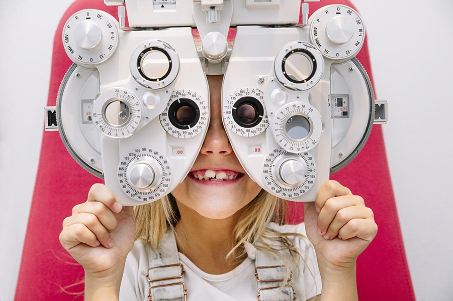 A girl receives a pediatric eye exam. Pediatric Eye Care, childrens eye, pediatric vision